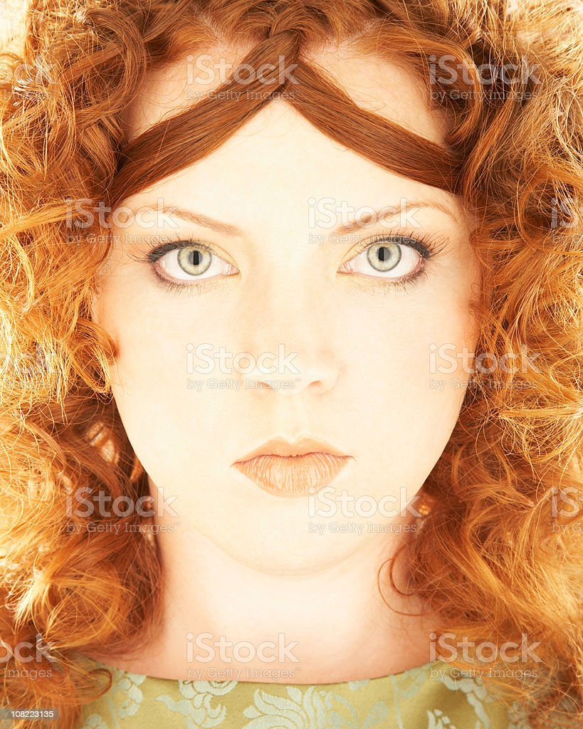 Young Woman with Curly Red Hair royalty-free stock photo
