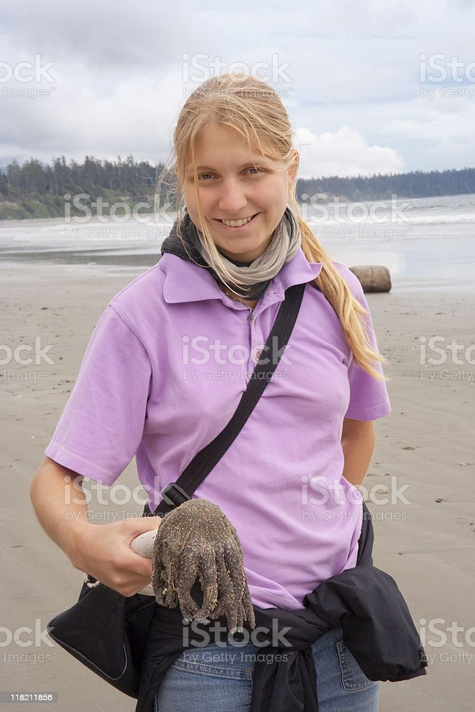Young Woman with dead Sunflower Sea Star royalty-free stock photo