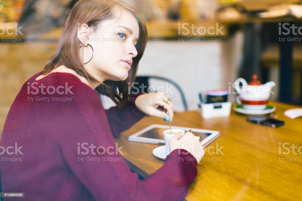 Young woman with digital tablet at cafe bar stock photo