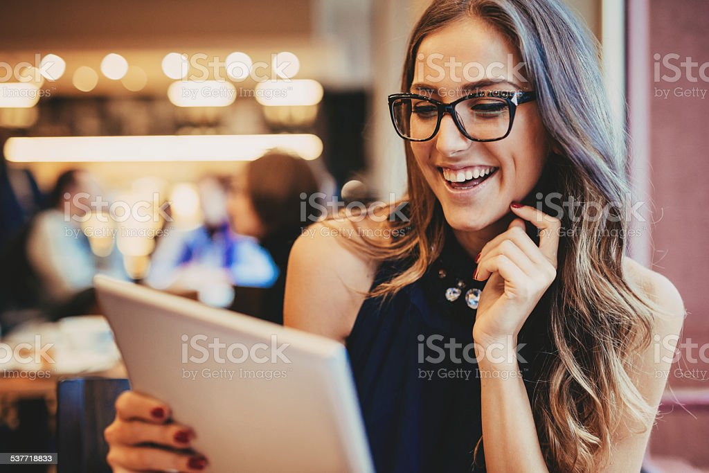 Young woman with digital tablet stock photo