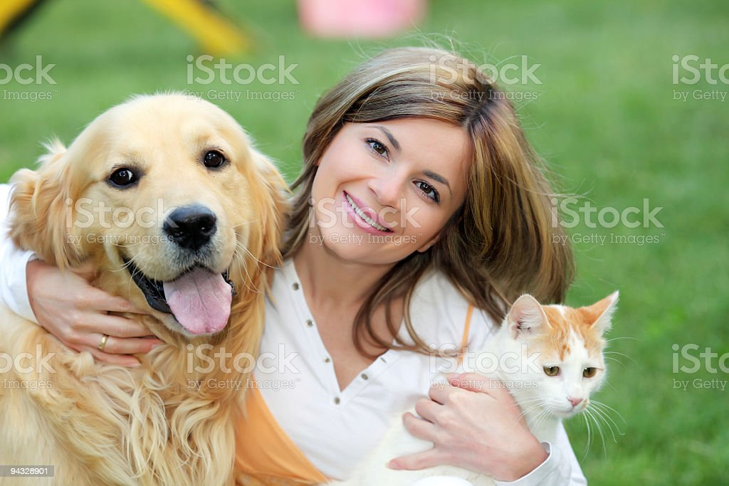 Young woman with dog and cat stock photo