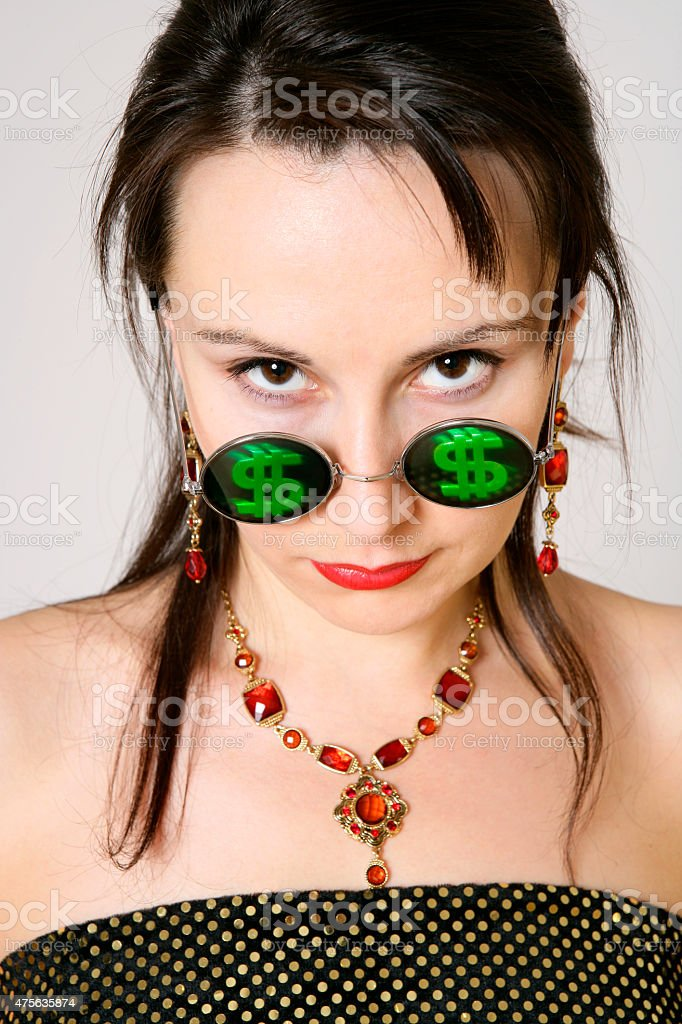 Young woman with dollar signs at her glasses stock photo