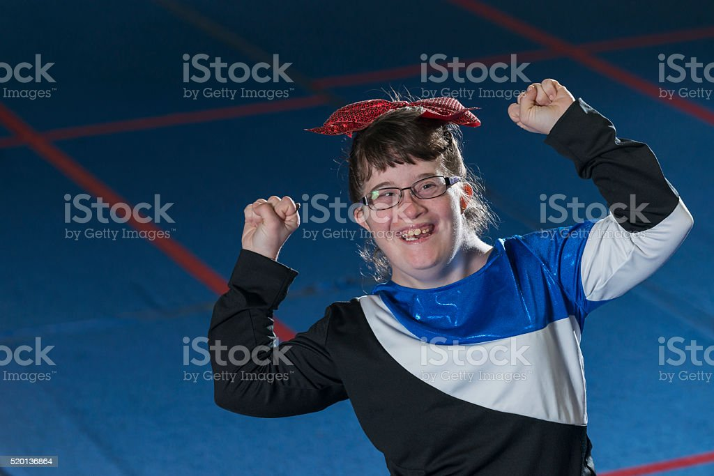 Young woman with down syndrome cheerleading stock photo