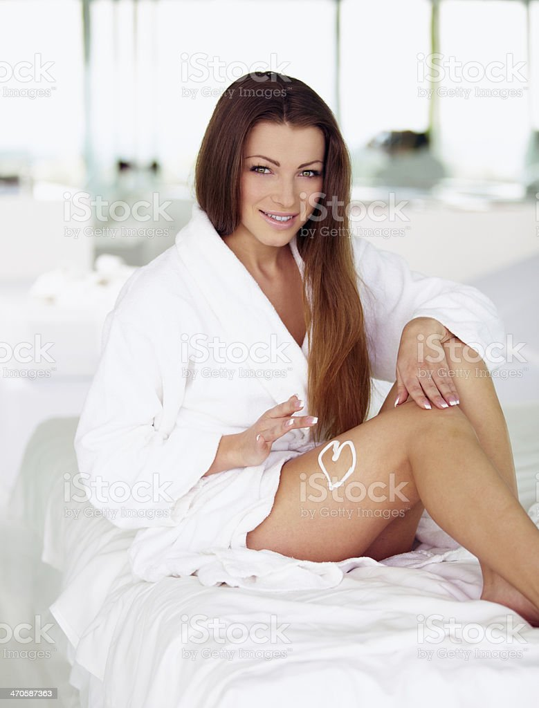 Young woman with drawn heart by creme royalty-free stock photo
