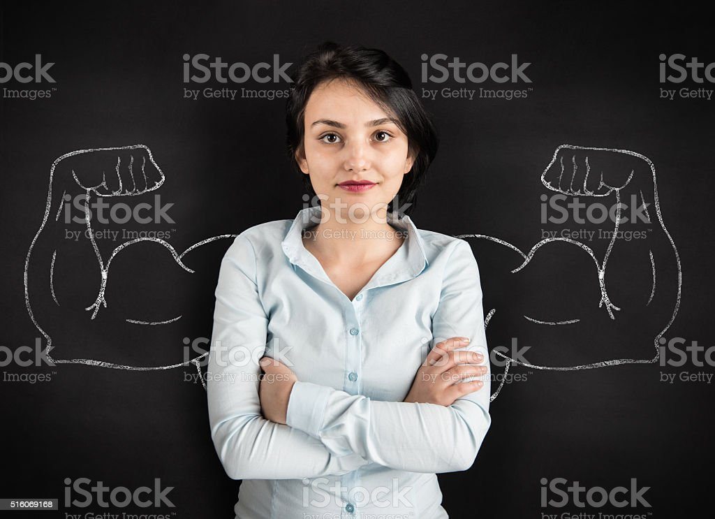 Young woman with drawn powerful arms stock photo