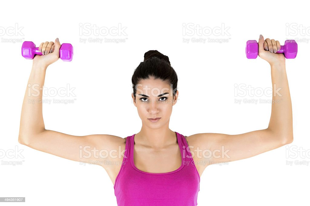 Young woman with dumbbells stock photo