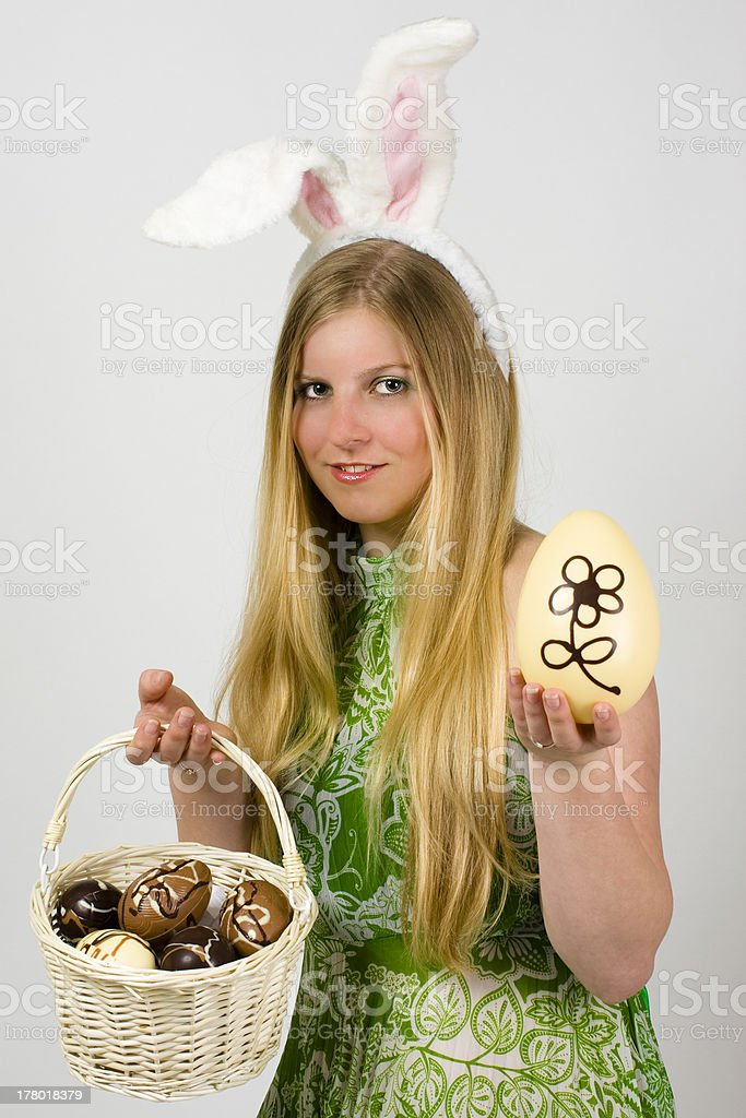 Young woman with Easter eggs in basket royalty-free stock photo