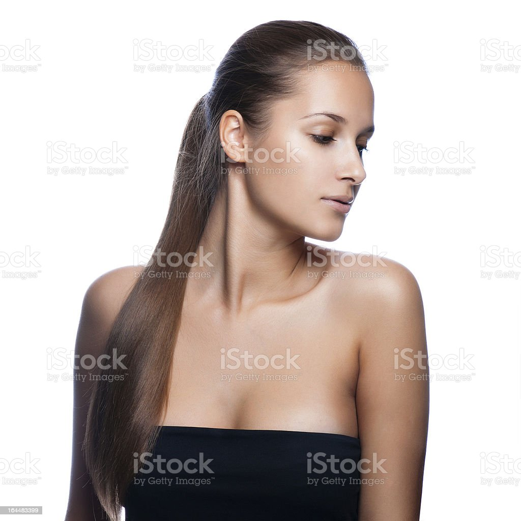 young woman with elegant long shiny hair royalty-free stock photo