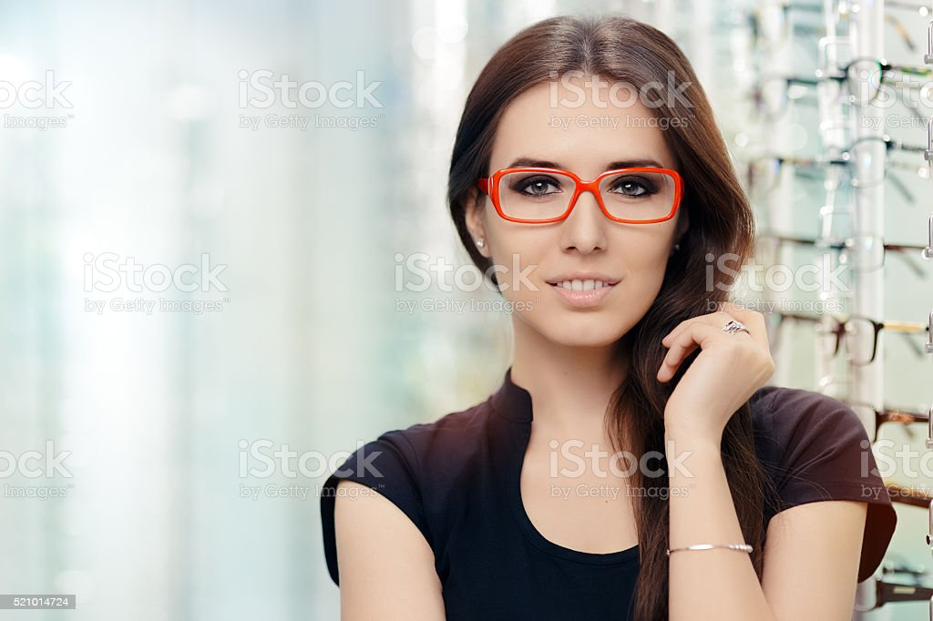Young Woman with Eyeglasses in Optical Store stock photo
