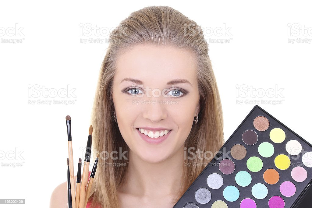 young woman with eyeshadow makeup palette royalty-free stock photo