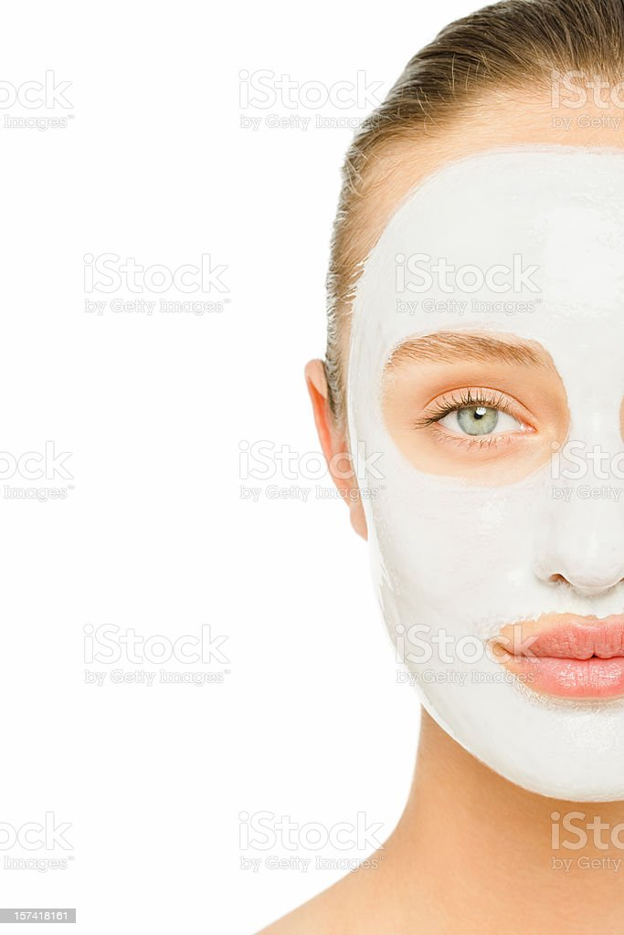 Young woman with facial mask stock photo
