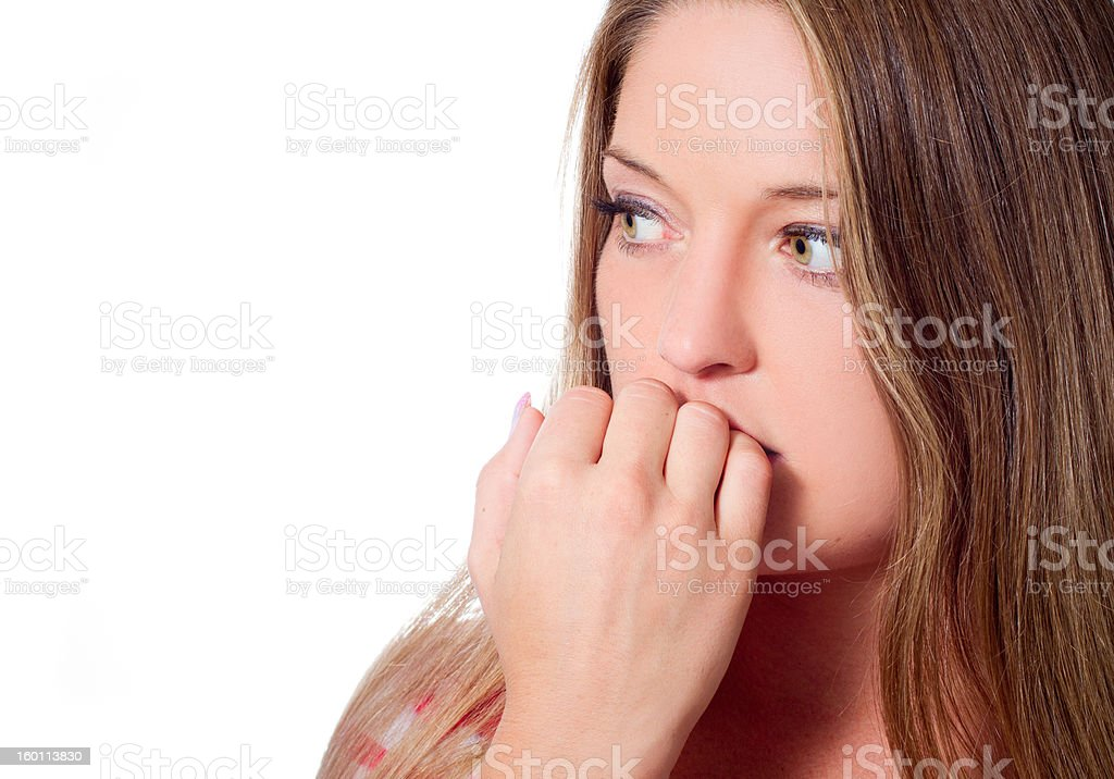 Young woman with fearful look on her face stock photo