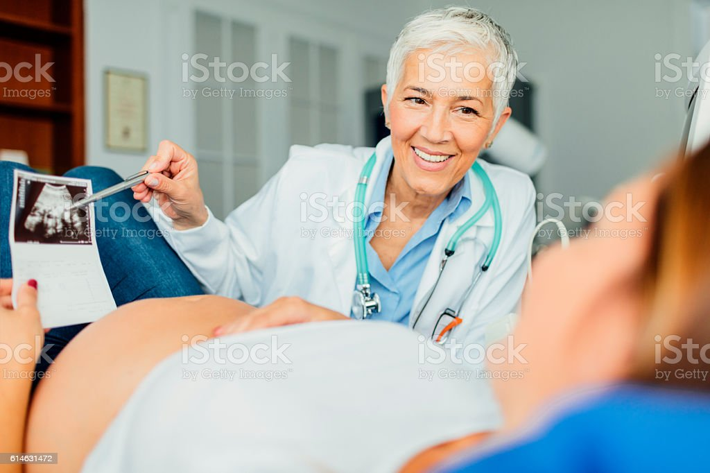 Young Woman with Female Doctor In A Consultation stock photo