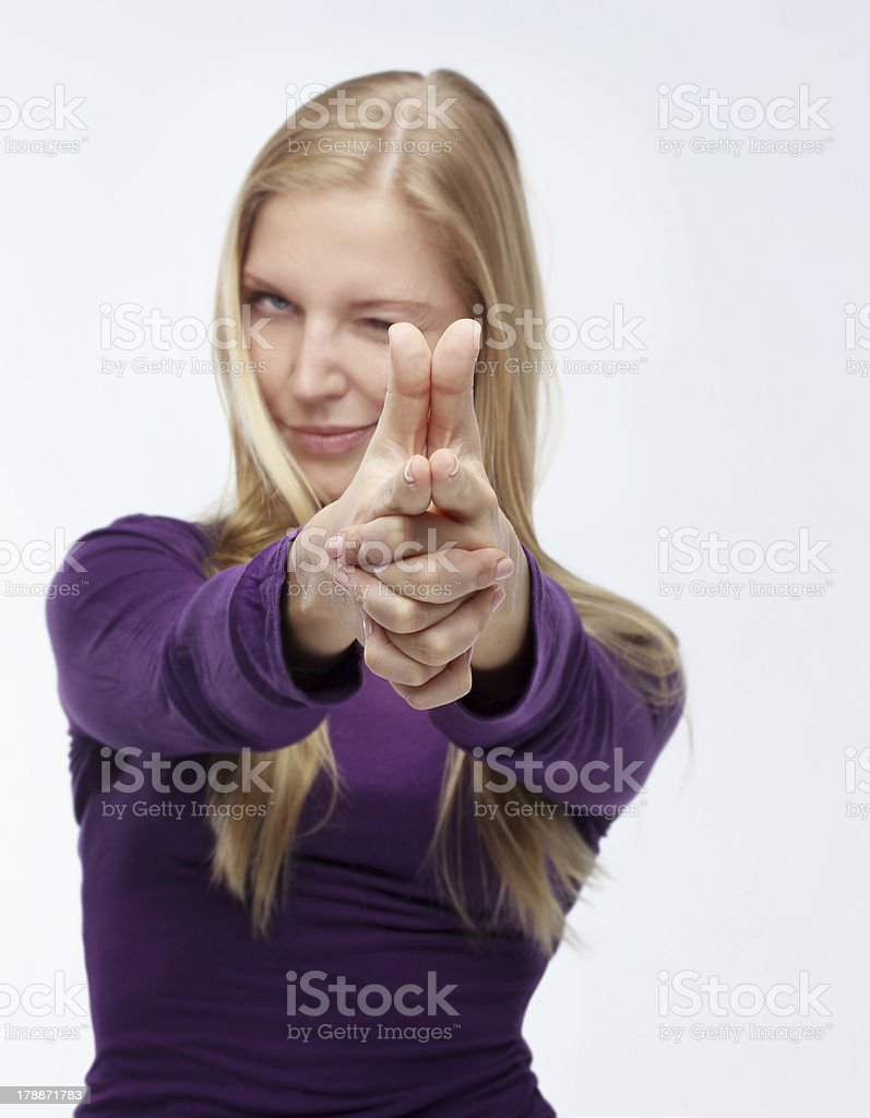 Young Woman With Finger Gun.Selective focus stock photo