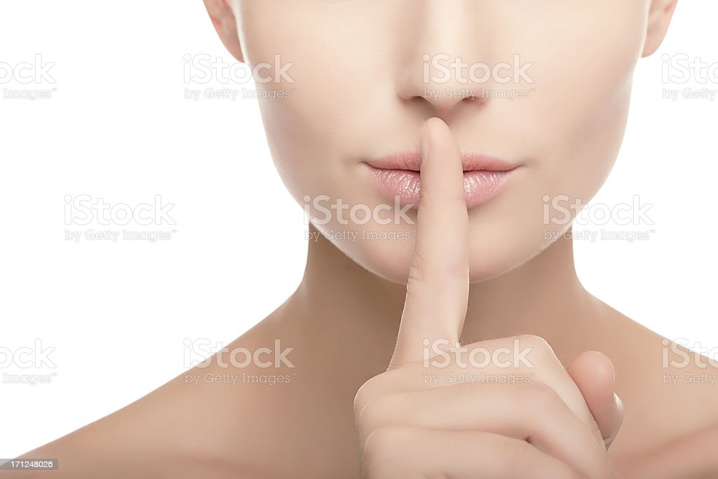 young woman with finger on her lips stock photo