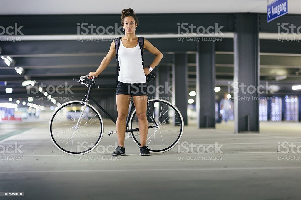 Young woman with fixed gear bicycle royalty-free stock photo