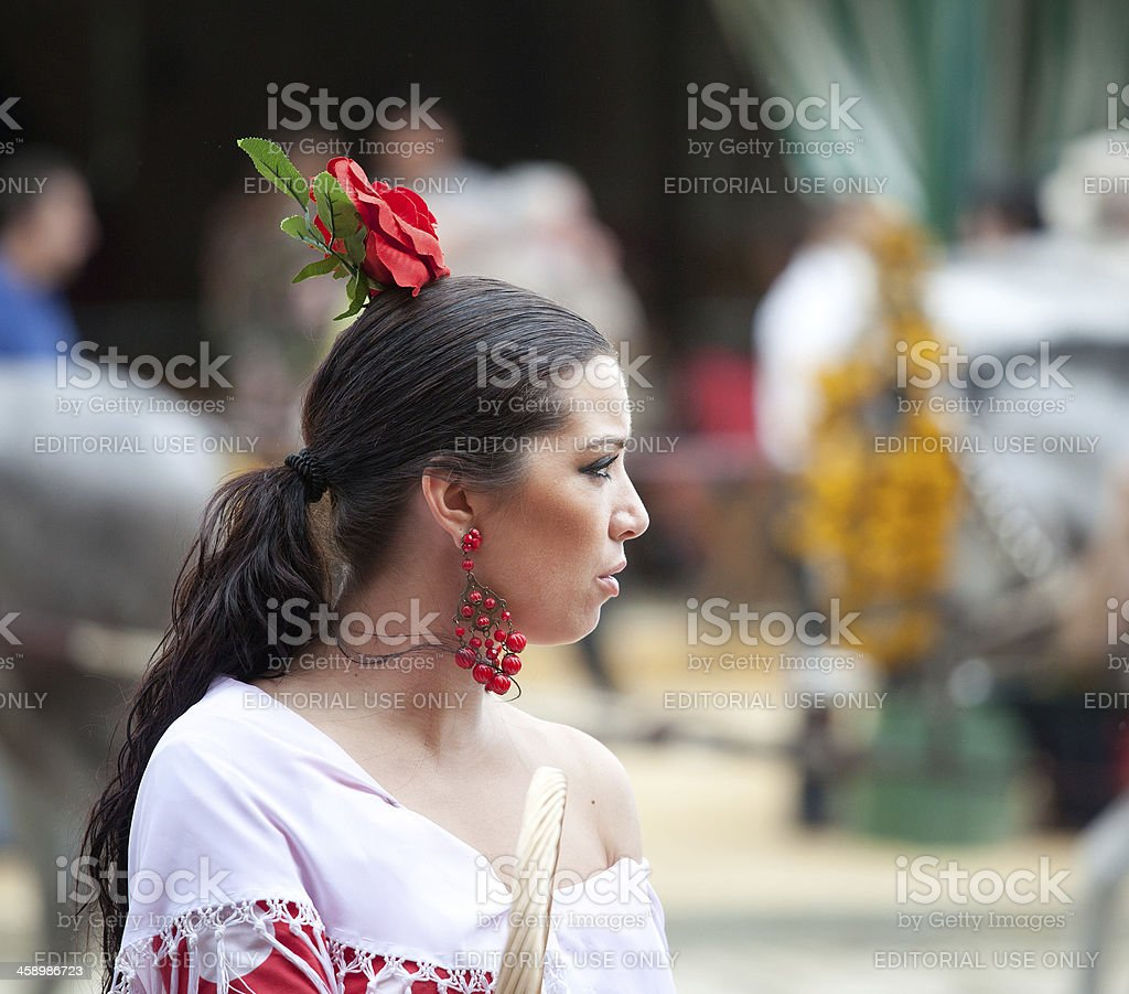 Young woman with flamenco dress during the April Fair stock photo