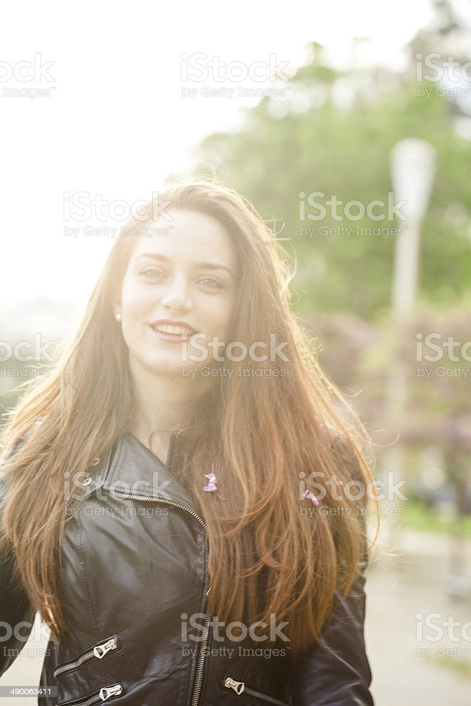 Young woman with flowers in her hair royalty-free stock photo
