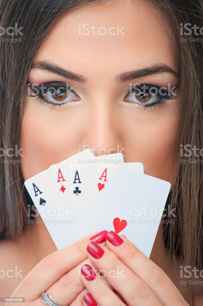 Young woman with four aces stock photo
