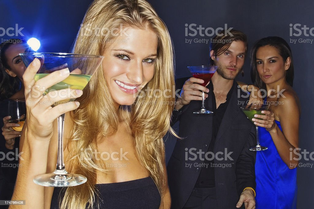 Young Woman With Friends Having Drinks At Nightclub. royalty-free stock photo