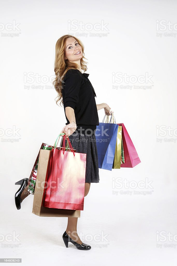 Young woman with full of bags royalty-free stock photo