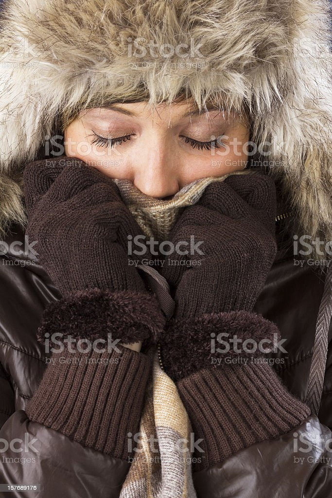 Young woman with fur hat, scarf and gloves stock photo