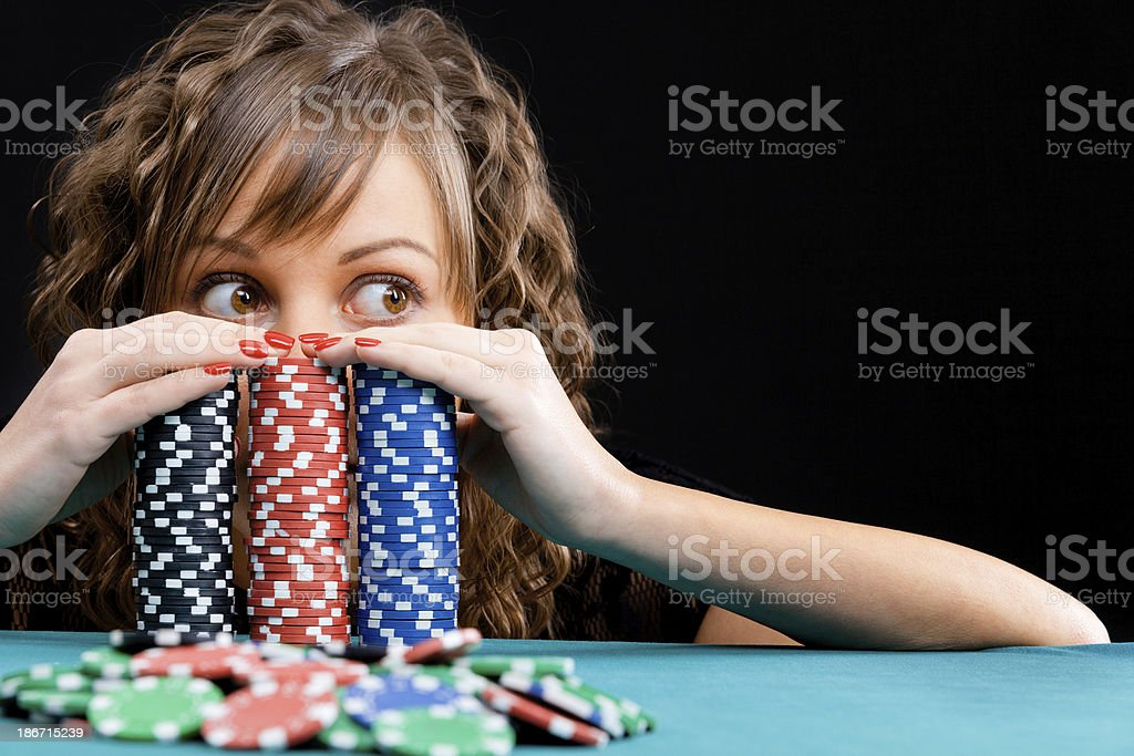 Young woman with gambling chips stock photo