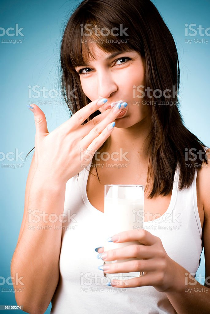 Young woman with glass of milk royalty-free stock photo