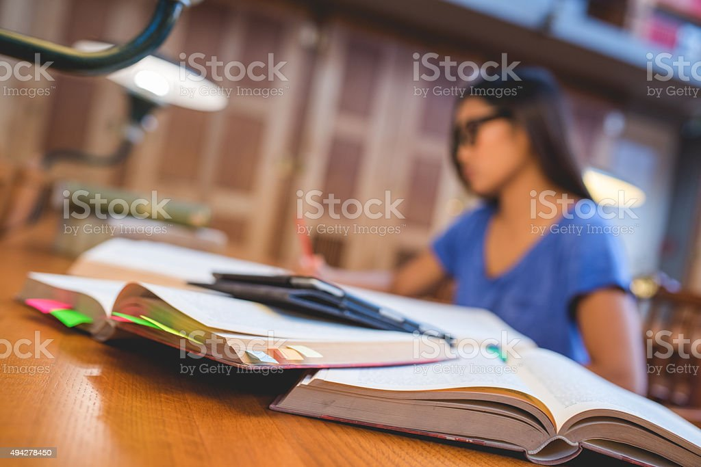 Young woman with glasses in Library stock photo