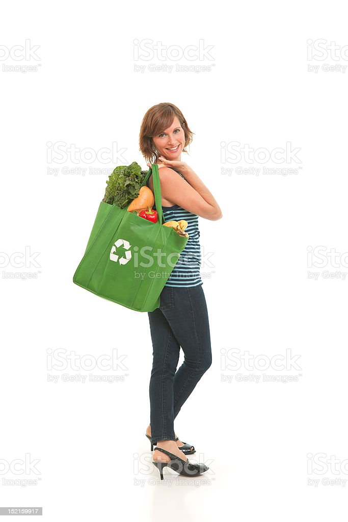 Young woman with green bag of healthy food and vegetables stock photo