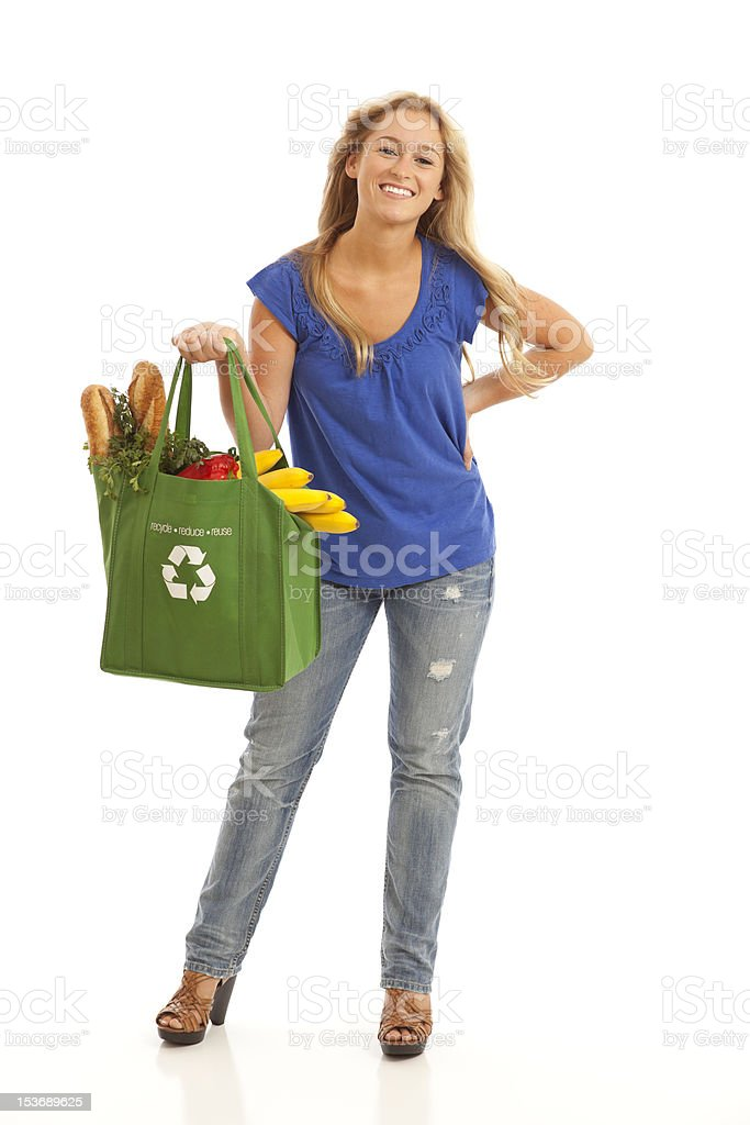 Young woman with groceries stock photo