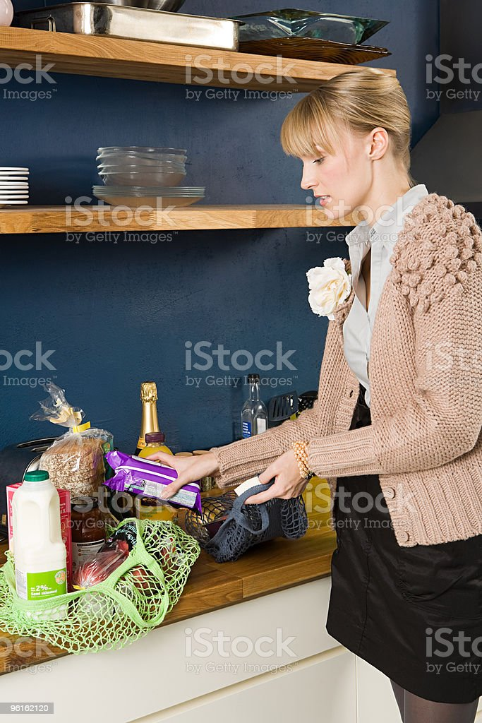 Young woman with grocery shopping royalty-free stock photo