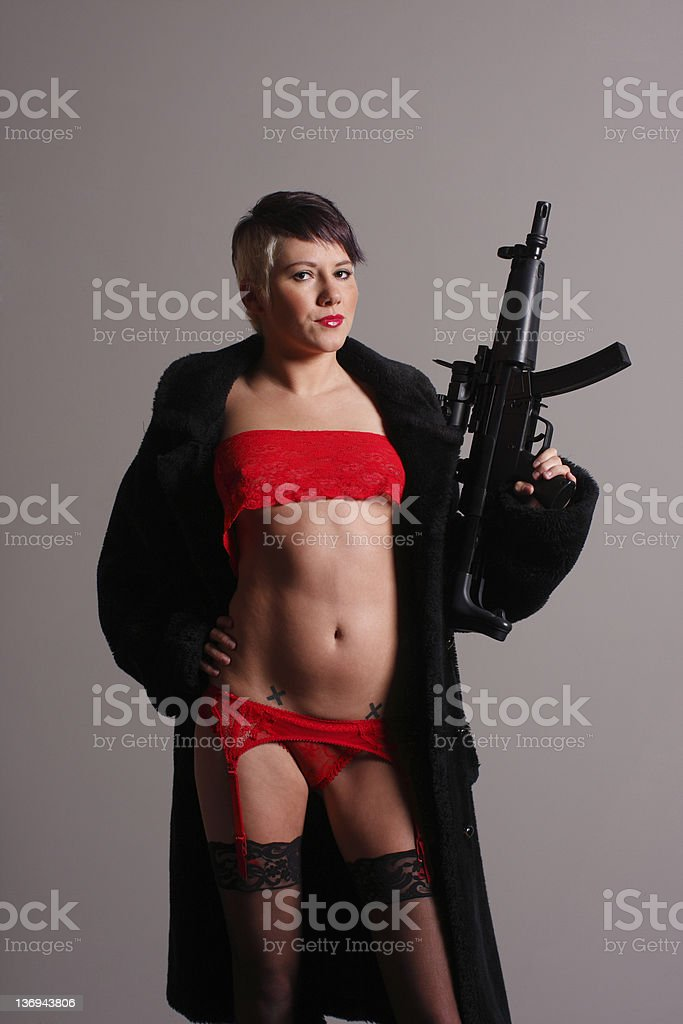 Young woman with gun royalty-free stock photo