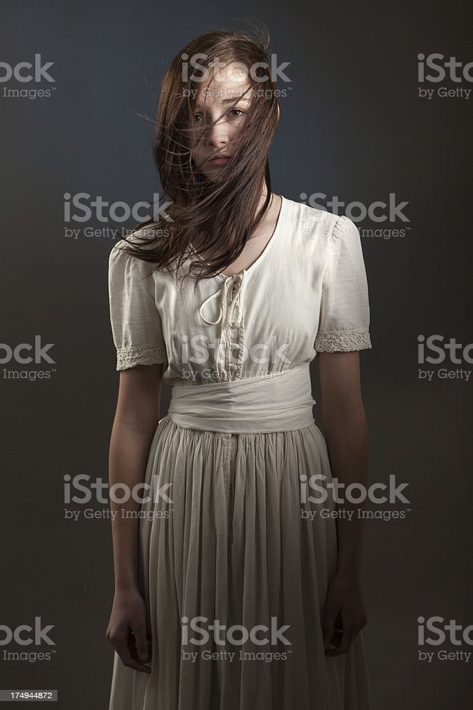 Young Woman with Hair Blowing Across Face stock photo