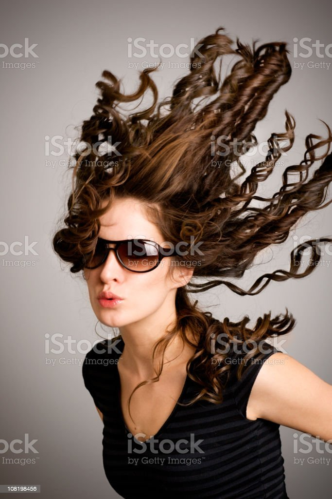 Young Woman With Hair Blowing in Wind stock photo