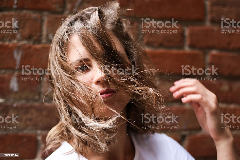 Young woman with hair blowing stock photo