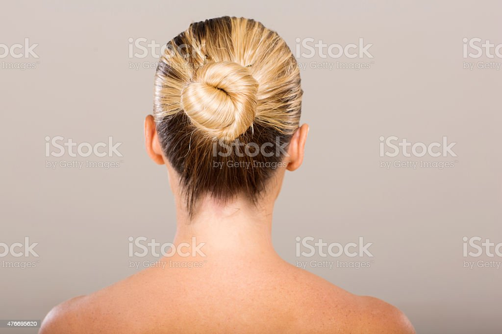 young woman with hair bun stock photo