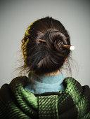 Young woman with hair bun.