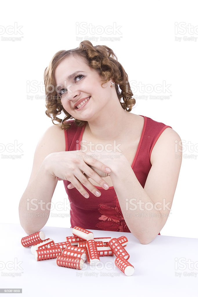 Young woman with hair-curlers. royalty-free stock photo