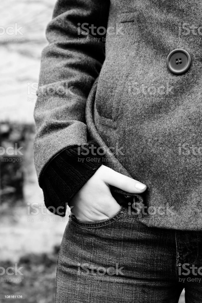 Young Woman with Hand in Pocket, Black and White royalty-free stock photo