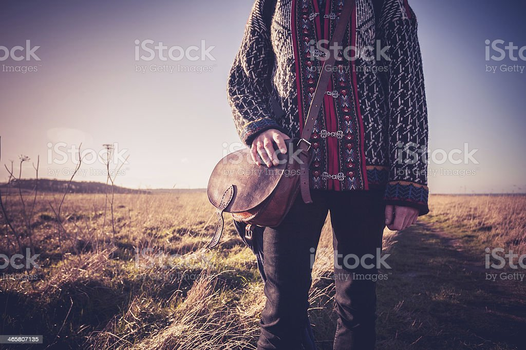 Young woman with handbag standing on nature trail royalty-free stock photo