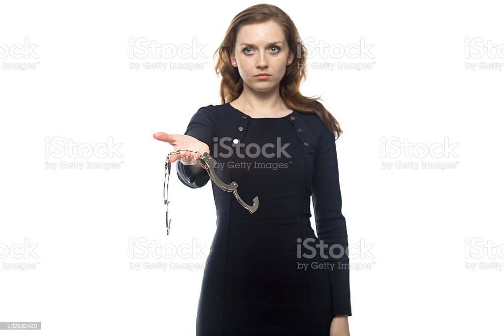 Young woman with handcuffs stock photo