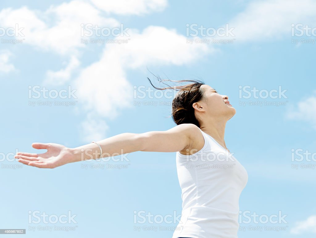 Young woman with hands stretched stock photo