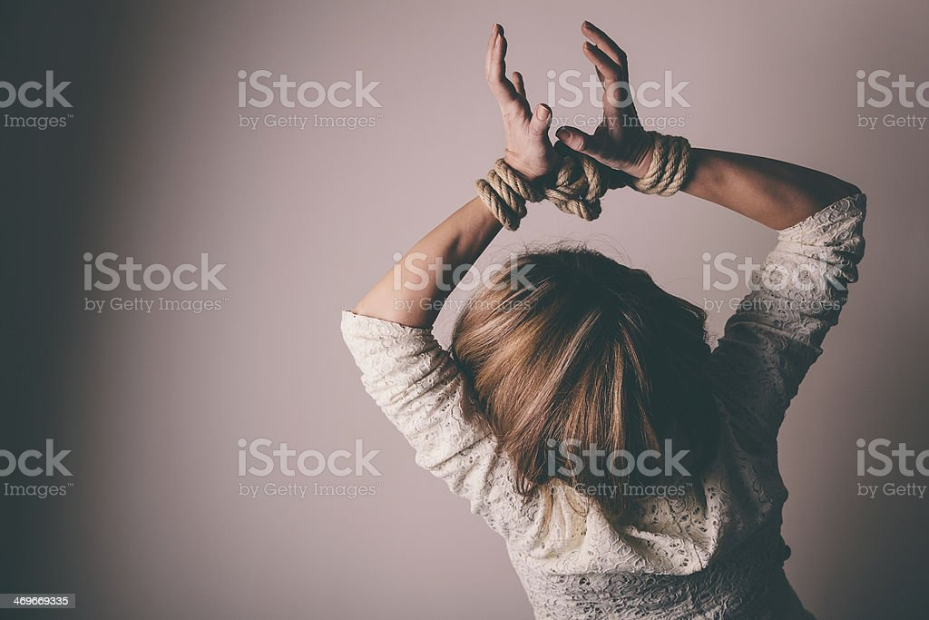 Young woman with hands tied over her head stock photo
