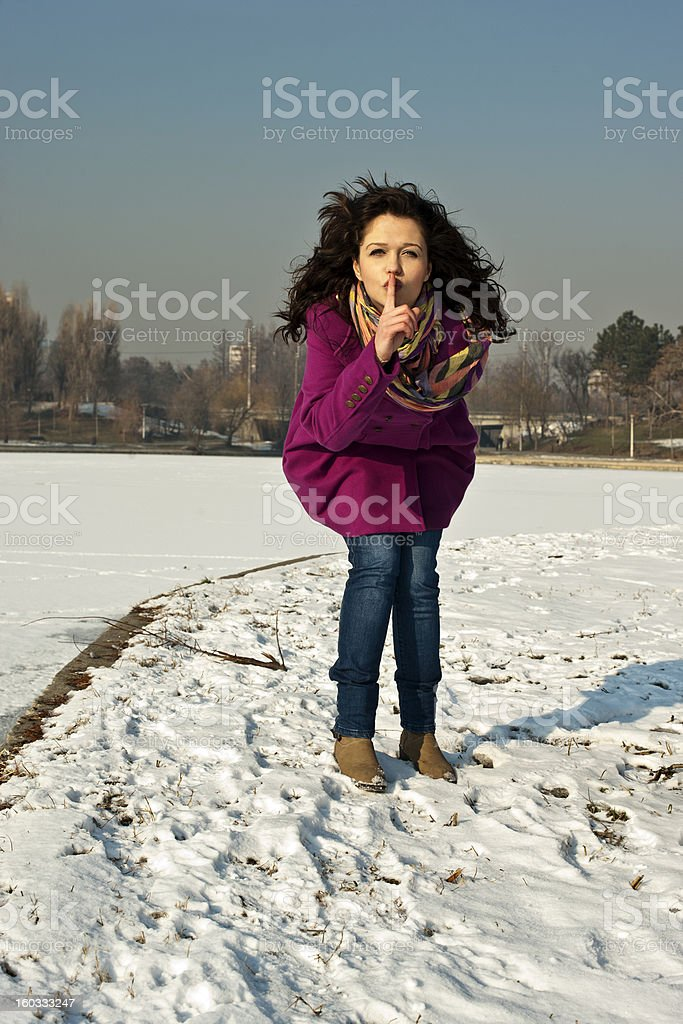 Young woman with happy face showing silent sign royalty-free stock photo