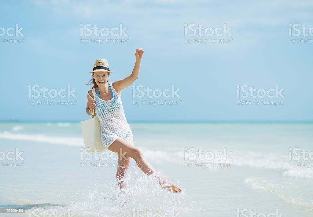 Young woman with hat  having fun time at seaside stock photo