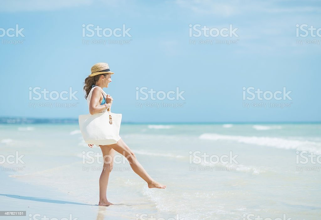 Young woman with hat having fun time on sea coast stock photo