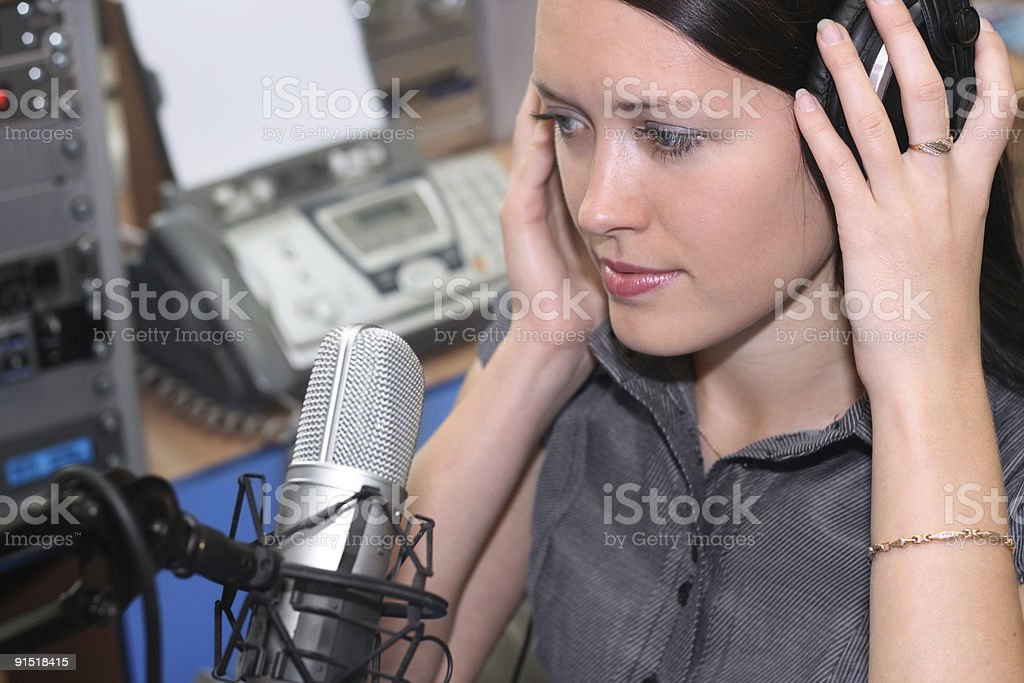 Young Woman with headphones recording in studio stock photo