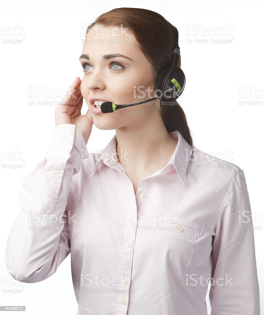 Young woman with headphones, smiling and focused royalty-free stock photo