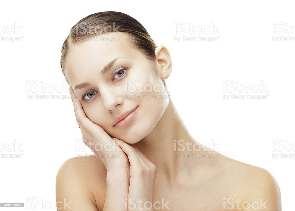 Young woman with healthy clean skin touching her face stock photo